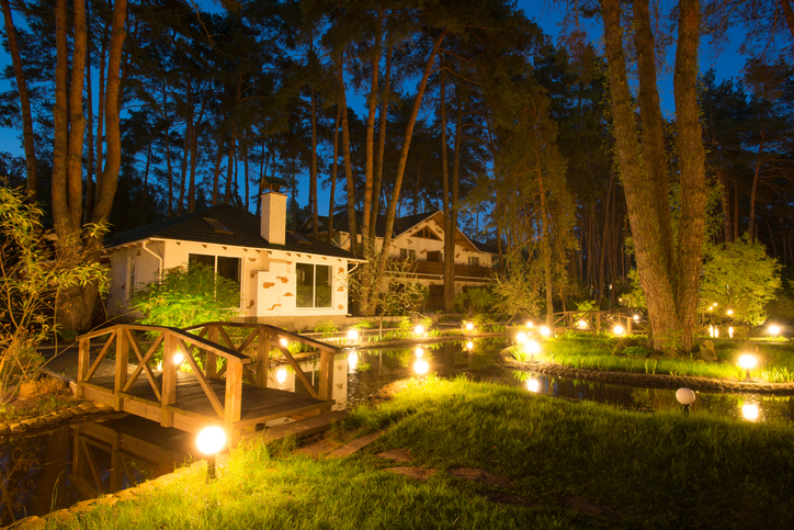 outdoor setting illuminated by landscape lighting
